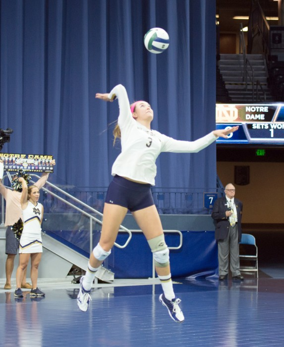 Irish freshman middle blocker Sam Fry goes up for a serve during Notre Dame's 3-1 loss to TCU on Sept. 12 at Purcell Pavilion.