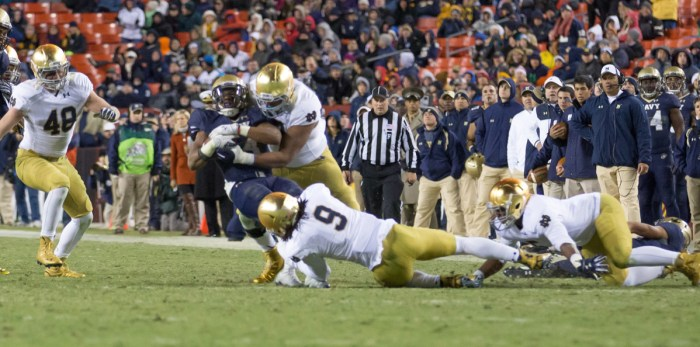 Irish sophomore defensive end Isaac Rochell and sophomore linebacker Jaylon Smith gang up to bring down a Navy ballcarrier during Notre Dame's 49-39 win Saturday.