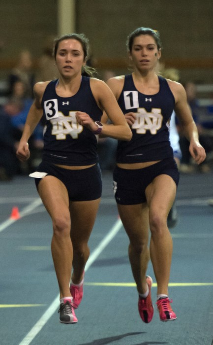 Irish junior Danielle Aragon, left, and freshman Jessica Harris race side-by-side during the 1,000-meter run Friday.