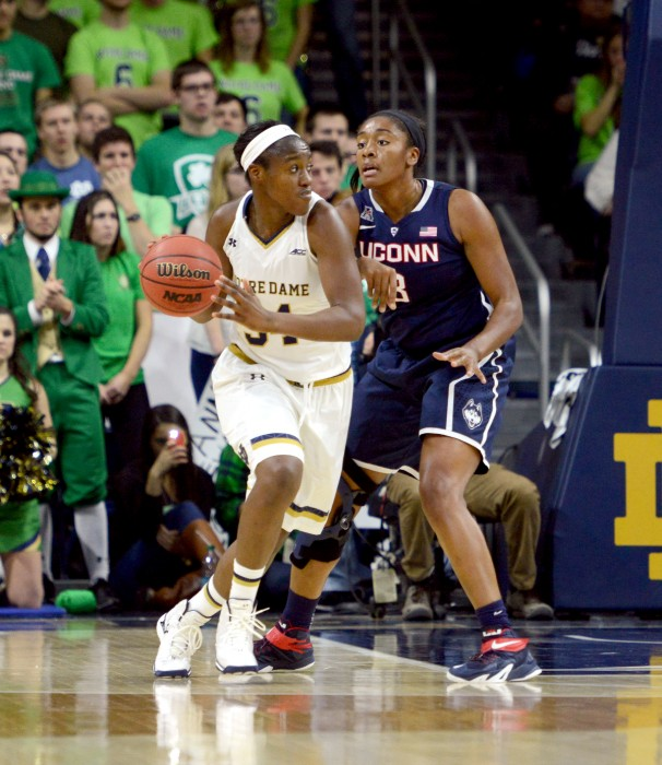 Irish senior forward Markisha Wright dribbles around a Connecticut defender during Notre Dame's 76-58 loss to the Huskies on Saturday in the Purcell Pavilion.