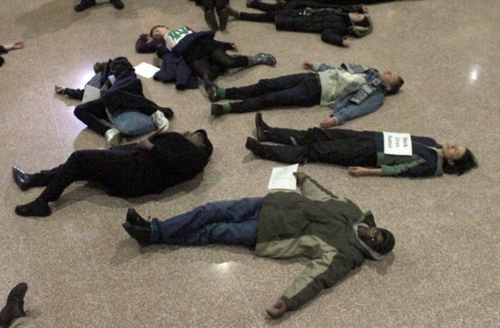 """Notre Dame students and South Bend community members """"die in"""" at the South Bend city council building on Monday to protest racism."""