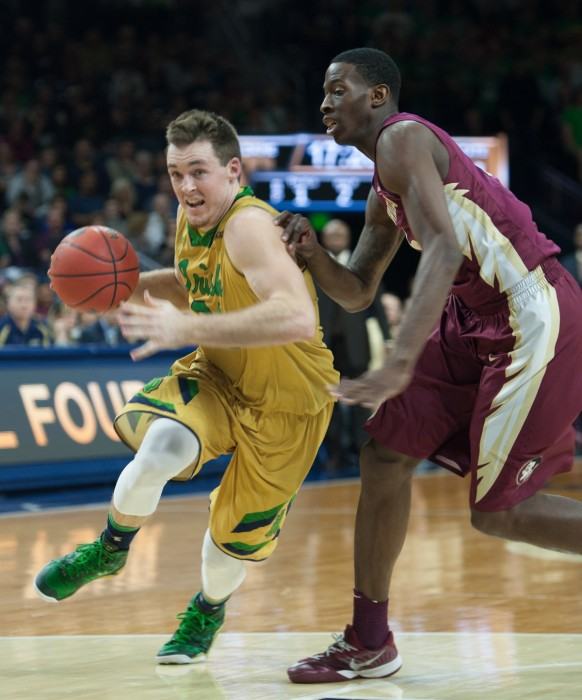 Irish senior guard Pat Connaughton drives into the lane against a Florida State defender in Notre Dame's 83-63 win Dec. 13 at Purcell Pavilion.