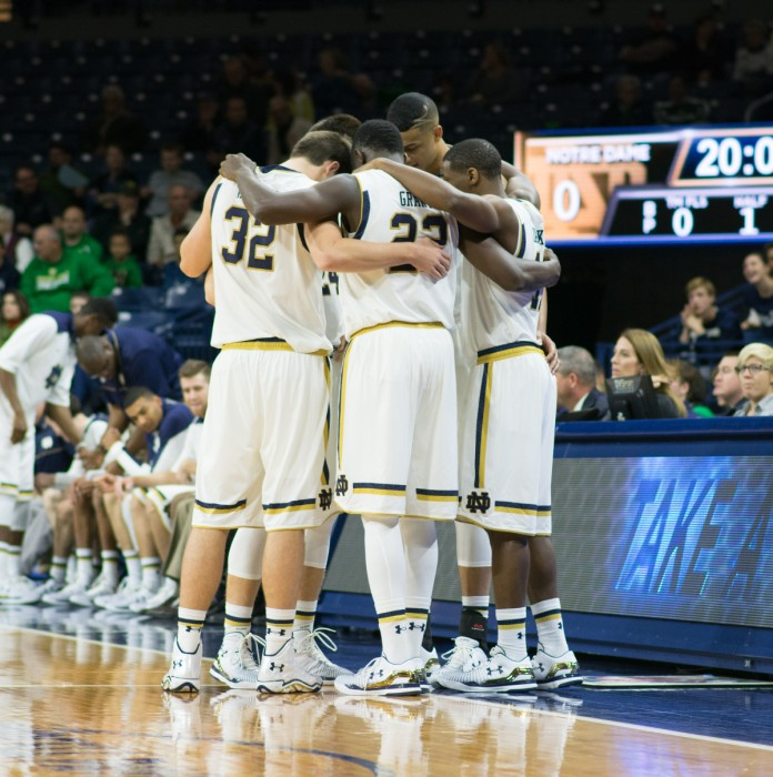 The Irish starting lineup gathers on the sideline before tip-off of its exhibition opener against Minnesota-Duluth on Nov. 1 at Purcell Pavilion.