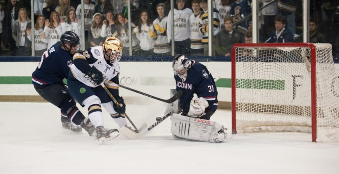 Irish junior left wing and alternate captain Sam Herr fires a shot towards UConn sophomore goaltender Rob Nichols during Friday's 3-3 tie between the Irish and the Huskies at Compton Family Ice Arena.