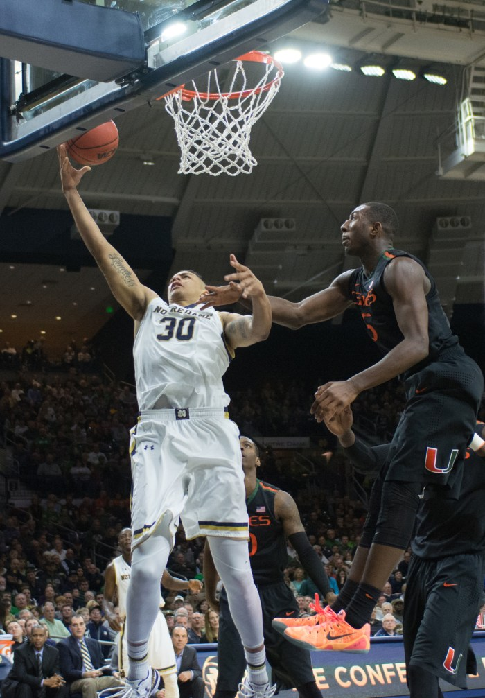 Irish junior forward Zach Auguste jumps up for a layup in a 75-70 Irish win against Miami on Saturday at Purcell Pavilion.