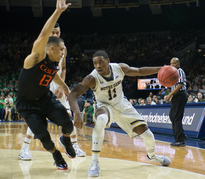 Irish sophomore Demetrius Jackson maneuvers around a defender during Notre Dame's 75-70 win over Miami on Jan. 17 at Purcell Pavilion. Jackson has turned the ball over just 25 times in 19 games this season.