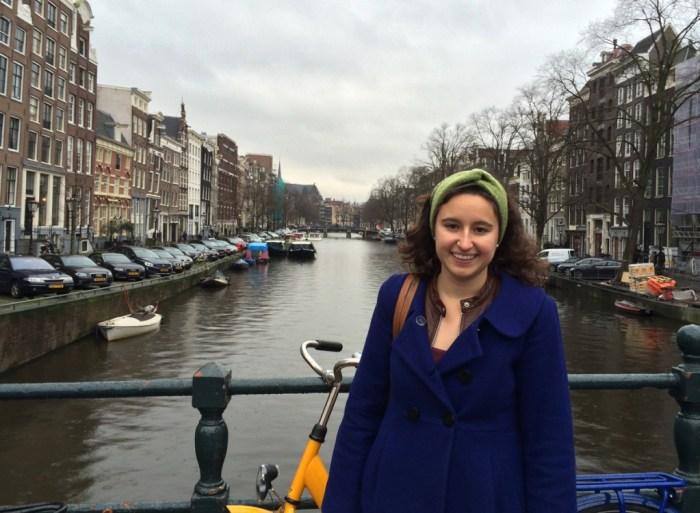 Senior Emmie Mediate stands on a bridge over the Singel canal, located near the Anne Frank House in Amsterdam. Mediate visited the Netherlands and Sweden during her winter break research trip.