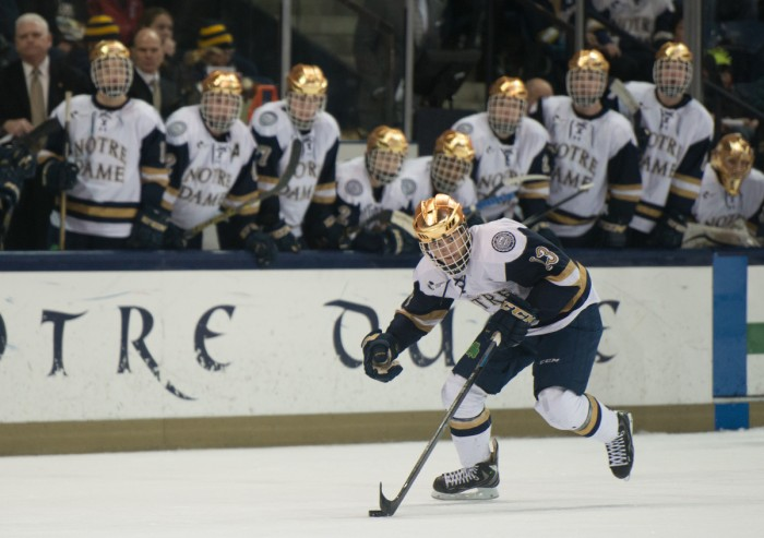 Notre Dame sophomore center Vince Hinostroza handles the puck in a 3-3 tie with Connecticut on Jan. 16.