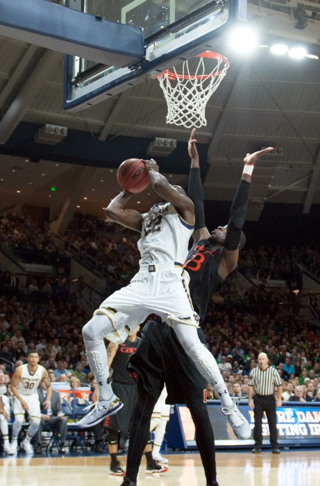 Irish senior guard Jerian Grant scores a bucket against traffic during Notre Dame's 75-70 win over Miami on Saturday at Purcell Pavilion.