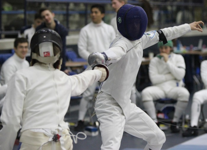Sophomore epee John Pietrowicz lunges during the DeCicco Duals at Joyce Fieldhouse on Feb. 9.