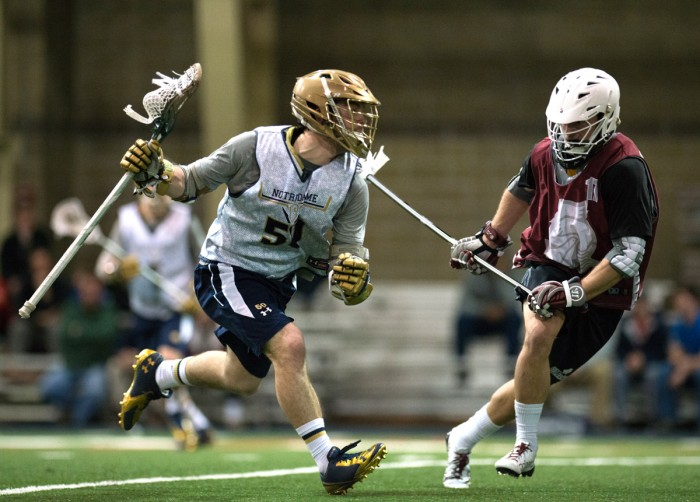 Notre Dame junior attacker Matt Kavanagh maneuvers around Bellarmine's defense in an exhibition match at Loftus Sports Center on Sunday.  Kavanagh tallied 42 goals last season.