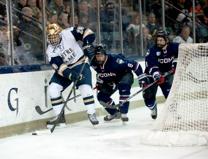 Notre Dame sophomore defenseman Justin Wade handles the puck during a 3-3 overtime tie with Connecticut in Compton Family Ice Arena.