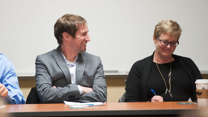 Panelists Kevin Donovan and Melissa Paulsen discuss effects of human dignity on developing countries.