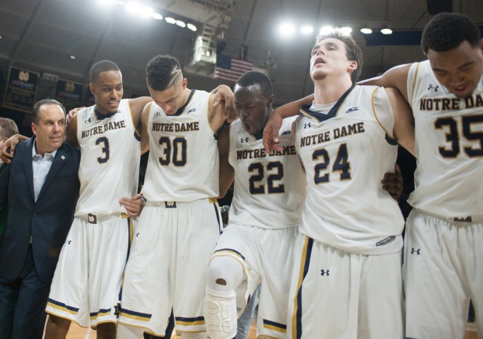 Irish senior guard Jerian Grant, center, and his teammates celebrate following their 77-73 win against Duke on Wednesday at Purcell Pavilion.