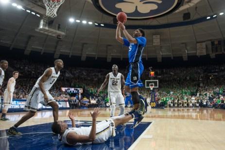 Duke freshman center Jahlil Okafor takes a shot after knocking down freshman forward Bonzie Colson. Michael Yu   The Observer