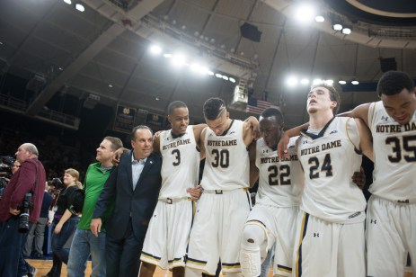 Notre Dame players celebrate after improving to 20-2 on the season following a 77-73 win over Duke at Purcell Pavilion on Wednesday. Michael Yu   The Observer
