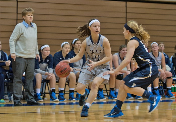 Saint Mary's junior guard Sarah Macius looks to pass during the Belles' 70-58 loss to Trine on Jan. 28.