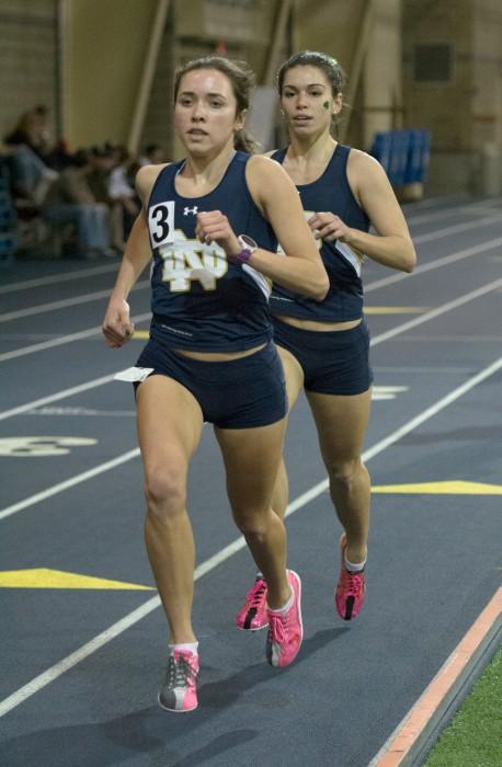 Irish junior Danielle Aragon leads freshman teammate Jessica Harris during a race at the Blue & Gold  Invitational Dec. 5 at Loftus Sports Center. Harris has set three Notre Dame records in her last three meets.