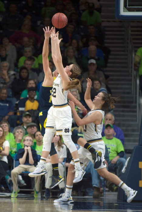 Irish senior guard Madison Cable out-jumps a Michigan opponent for a loose ball during Notre Dame's 70-50 win Dec. 13.