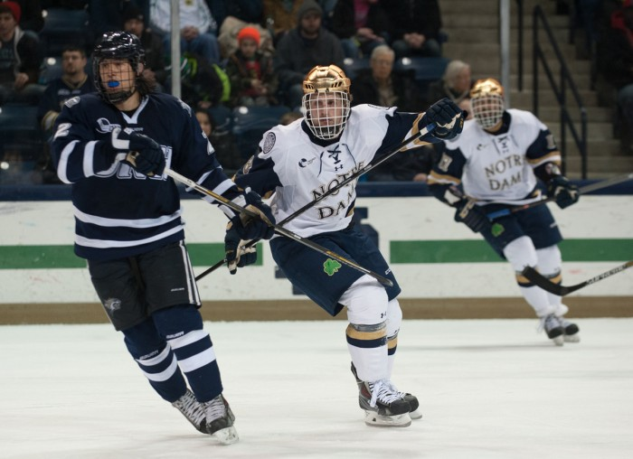 Sophomore right winger Ben Ostlie skates during Notre Dame's 5-2 loss to New Hampshire on Jan. 30 at Compton Family Ice Arena.