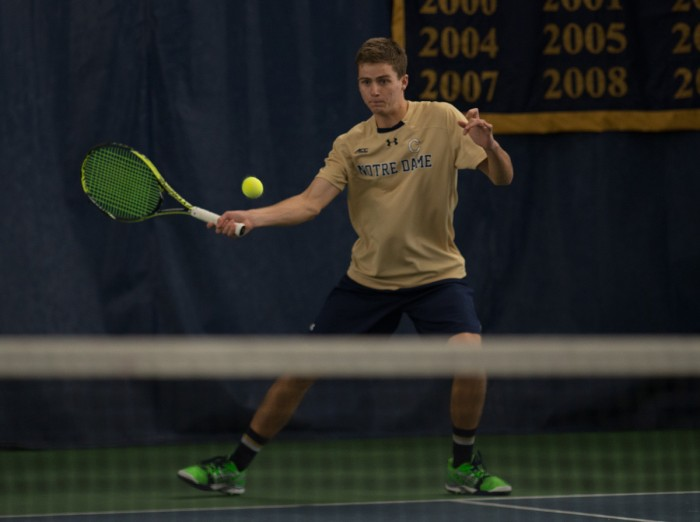 Irish junior Quentin Monaghan returns a shot during Notre Dame's 4-3 win over Oklahoma State on Jan. 24 at Eck Tennis Pavilion.