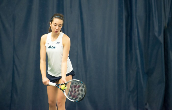 Irish junior Julie Vrabel prepares to serve during Notre Dame's 6-1 loss to Stanford on Friday at Eck Tennis Pavilion.