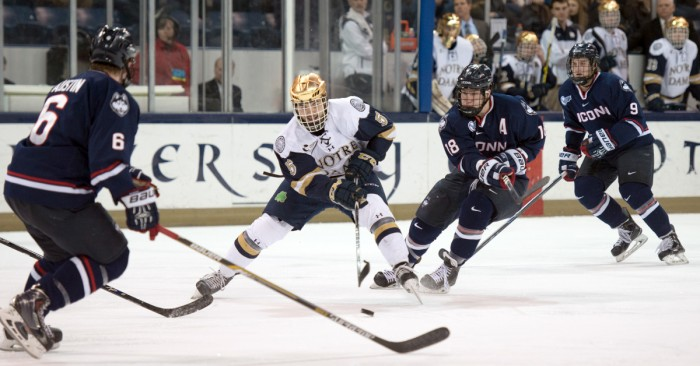 Irish senior defenseman Robbie Russo weaves through the UConn offensive zone during the two teams' 3-3 tie Jan. 16 at Compton Family Ice Arena. Russo leads all Irish defensemen with 25 points this season.