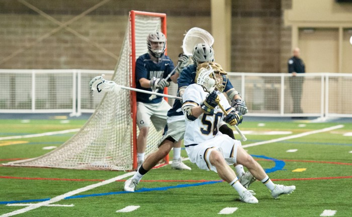 Irish sophomore attack Matt Kavanagh cuts back against a defender during Notre Dame's 14-12 win over Georgetown on Saturday.