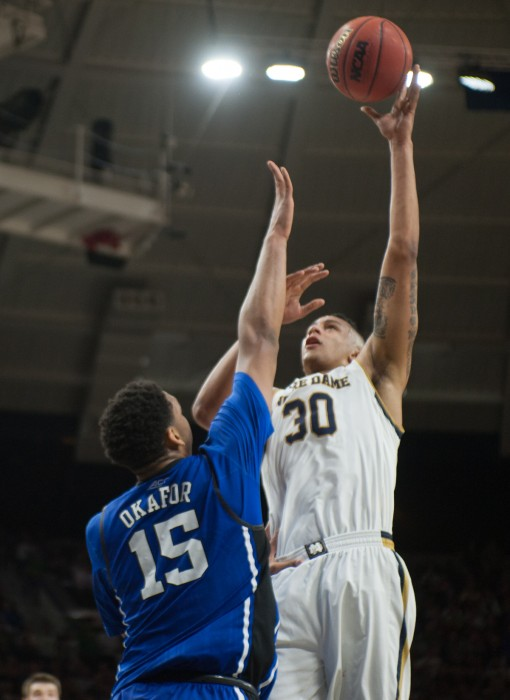 Irish junior forward Zach Auguste puts up a shot during Notre Dame's 77-73 win over Duke on Jan. 28 at Purcell Pavilion.