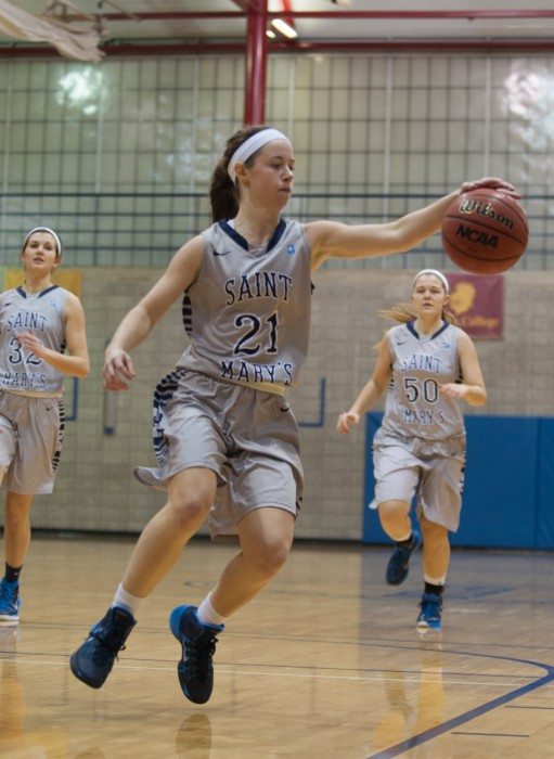 Saint Mary's junior guard Sarah Macius pulls in the ball during a 70-58 loss to Trine on January 28th at Angela Athletic Facility.