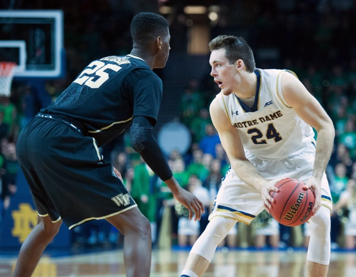 Irish senior guard/forward Pat Connaughton surveys the court during Notre Dame's 88-75 win over Wake Forest on Tuesday.