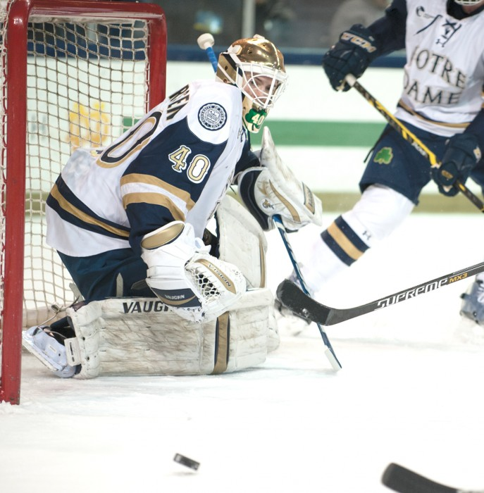 Irish freshman goaltender Cal Petersen watches a puck sail by in Notre Dame's 5-2 loss to New Hampshire on Jan. 30.