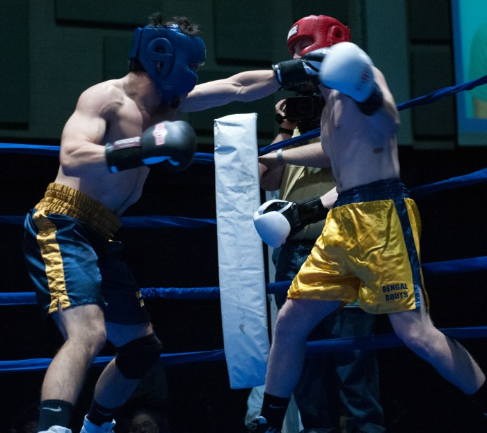 Senior Evan Escobedo, left, throws a punch during Tuesday's semifinal bouts at Joyce Fieldhouse. Escobedo, the president of Bengal Bouts, lost by unanimous decision to Keough Hall freshman Pat Gordon in the 196-pound weight class. The Fisher Hall resident previously served as a Bengal Bouts captain before becoming president this year.