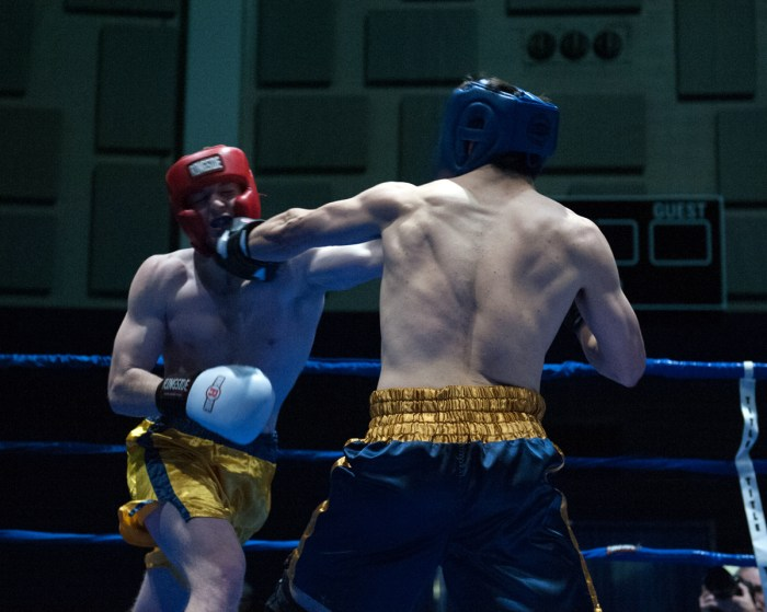 Bengal Bouts president Evan Escobedo, right, fights freshman Pat Gordon during the Bengal Bouts semifinals at Joyce Fieldhouse.