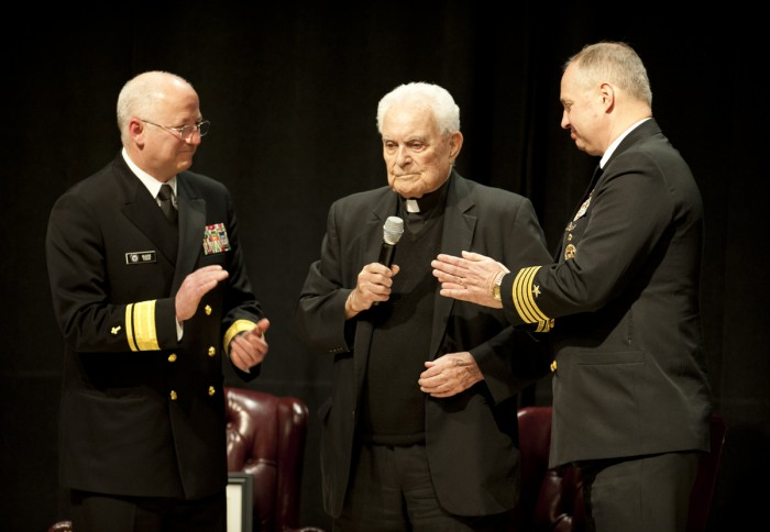 Fr. Theodore Hesburgh, center, speaks during his ceremony to become an honorary naval chaplain on April 17, 2013. Rear Admiral Mark Tidd, chief of U.S. Navy chaplains, stands to Hesburgh's left, and Captain Earl Carter, then-commanding officer of Notre Dame's Navy Reserve Officer Training Corps, stands to his right.