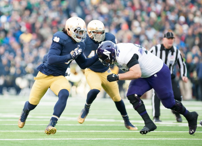 Irish junior linebacker Jaylon Smith takes on a block during Notre Dame's 40-43 loss to Northwestern on Nov. 15  at Notre Dame Stadium.