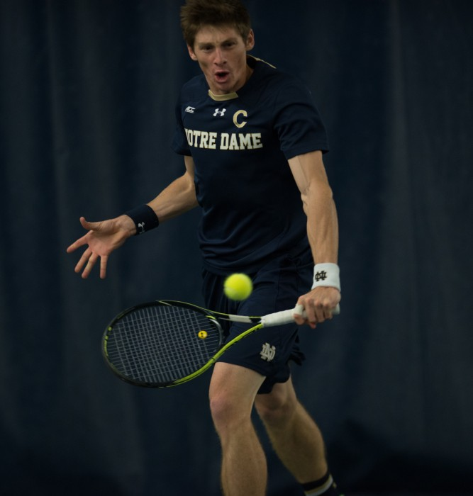 Junior Alex Lawson strikes the ball during Notre Dame's 4-3 win over Oklahoma State on Jan. 24 at Eck Tennis Pavilion. Lawson lost in three sets to Cowboys senior Nicolai Ferringo.