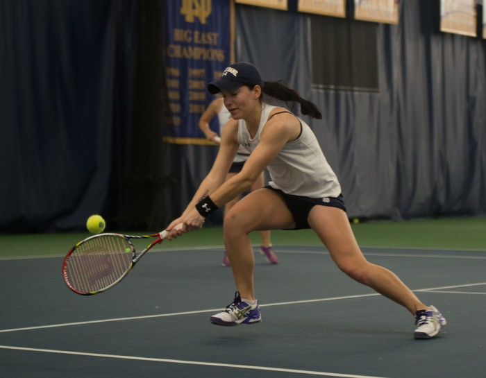 Notre Dame freshman Allison Miller stretches for a backhand  during her and junior Julie Vrabel's Feb. 4 doubles match against Stanford.