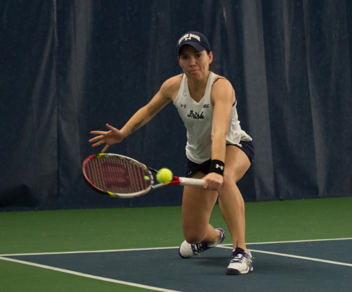 Freshman Allison Miller reaches for a backhand in a 6-1 loss to  Stanford on Feb. 6 at Eck Tennis Pavilion.