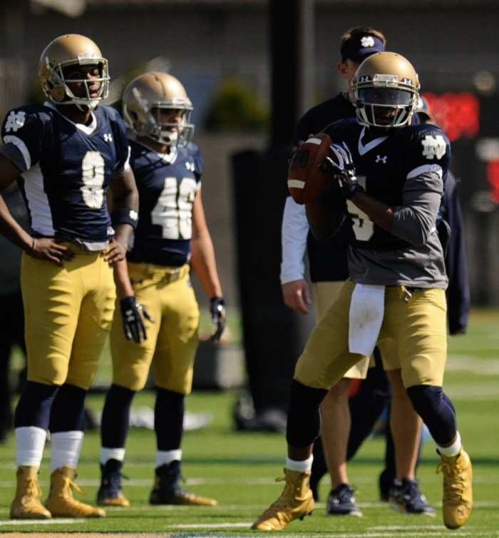 Irish junior quarterback Malik Zaire (8) looks on while graduate student Everett Golson (5) prepares to toss a pass during a drill at LaBar Practice Complex last Saturday.