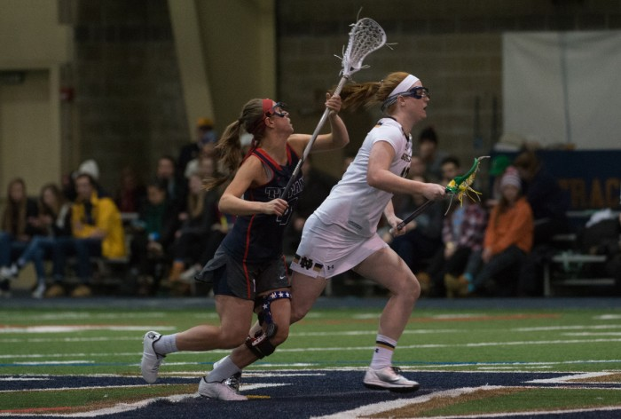 Junior midfielder Brie Custis races forward for the ball against  Detroit on Feb.15. Custis and the Irish sprinted past the Titans, 17-5, in their home opener.