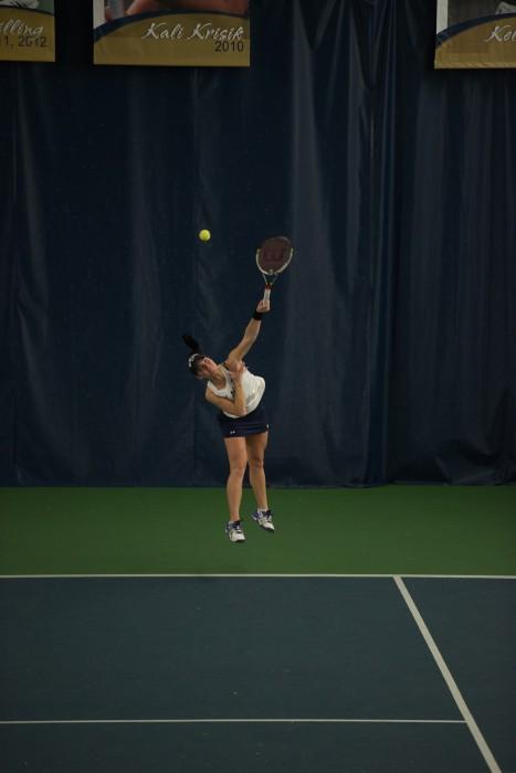 Irish freshman Allison Miller serves  during Notre Dame's 6-1 loss to Stanford on Feb. 6 at Eck Tennis Pavilion.