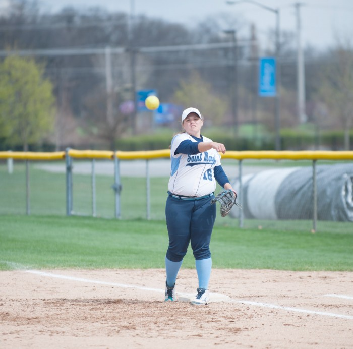 Belles sophomore first baseman Caitlyn Migawa throws the ball back to the pitcher during a 9-6 victory over Kalamazoo as part of a doubleheader April 21 at Saint Mary's Softball Fields.