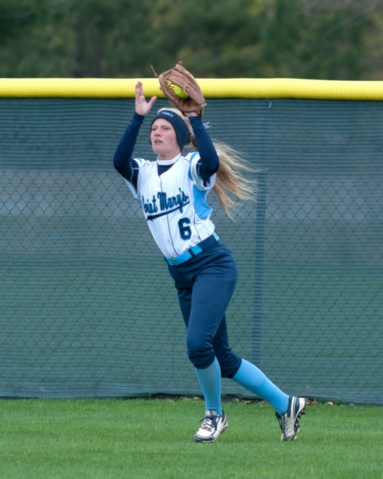 Freshman Cassie Young fields a fly ball during a 9-6 win against Kalamazoo on April 21 at Saint Mary's Softball Field.