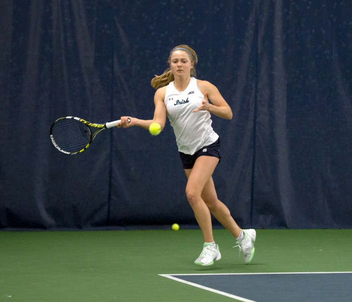 Notre Dame sophomore Monica Robinson winds up for a hit during a match against Stanford on Feb. 6 at Eck Tennis Pavilion. The Irish fell to the Cardinal, 6-1.