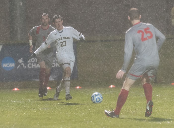 Irish senior midfielder Patrick Hodan fights through the rain during Notre Dame's 2-1 win over Ohio State on  Nov. 23 at Alumni Stadium.