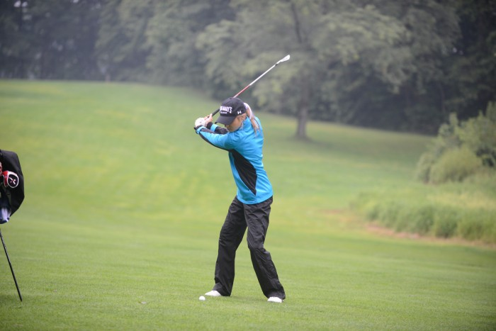 Junior Ali Mahoney swings during an individual fifth-place finish at the Michiana Crosstown Clash at Elbel Golf Course on Aug. 29.