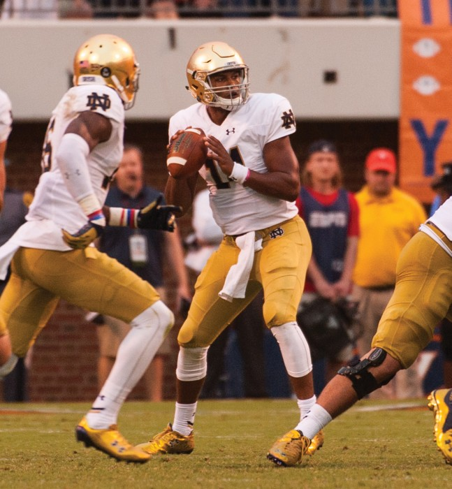 Irish quarterback DeShone Kizer drops back to pass during Notre Dame's 34-27 win over Virginia at Scott Stadium on Saturday. The sophomore threw two touchdown passes, including the game winner.