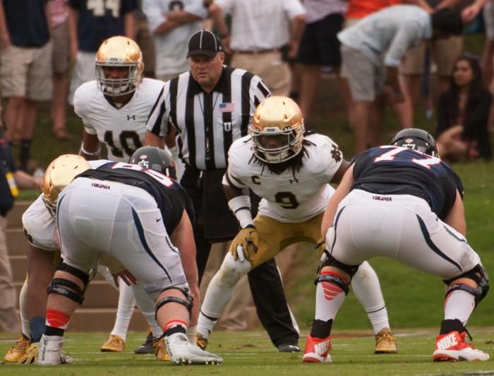 Irish junior linebacker Jaylon Smith, center, lines up before a snap during Notre Dame's 34-27 win over Virginia on Saturday at Scott Stadium in Charlottesville, Virginia.