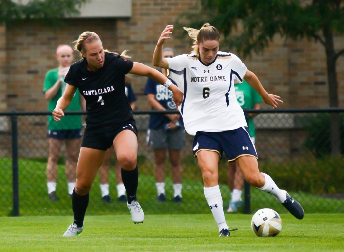 Senior forward Anna Maria Gilbertson fights for position in a 2-1 victory against Santa Clara on Aug. 28 at Alumni Stadium.